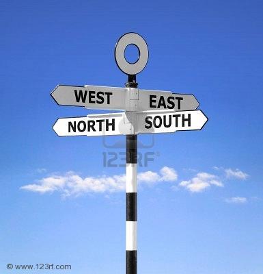 20110327225056-3517449-direcci-n-indicador-que-muestra-todos-los-puntos-cardinales-norte-sur-este-y-el-oeste-contra-un-bril.jpg